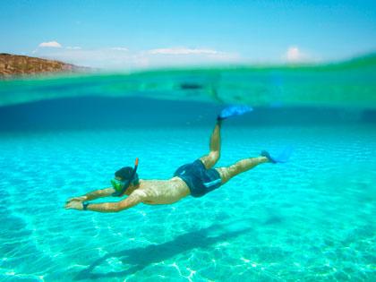 man underwater snorkeling